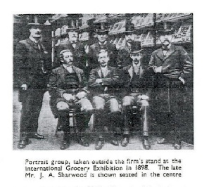 Group portrait from 1950 Grocer article on James Allen Sharwood