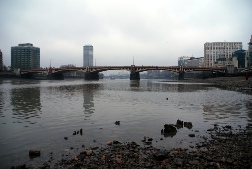 The Thames at low tide looking towards Vauxhall Bridge with Bronze age timbers in foreground