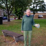 Resident removes rubbish at Claylands Green